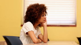 Bored student looking at the camera in classroom stock video footage