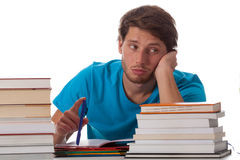Bored student sitting in library Stock Photos