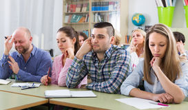 Bored students sitting at lesson Royalty Free Stock Photography