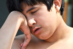 Bored Teen. A handsome teeanger is boring during his vacations Royalty Free Stock Images
