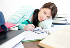 Bored teen girl studying Royalty Free Stock Images