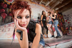 Bored Teen Sitting. Bored teen with chin in hands near group Royalty Free Stock Image