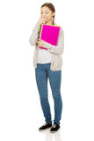 Bored teen woman with notebook. Royalty Free Stock Image