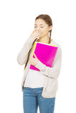 Bored teen woman with notebook. Royalty Free Stock Photography