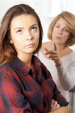 Bored Teenage Girl Being Told Off By Mother Stock Image