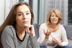 Bored Teenage Girl Being Told Off By Mother