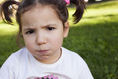 Bored three years old little girl Stock Photo