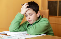 Bored and tired boy doing homework Royalty Free Stock Image