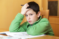 Bored and tired boy doing homework Royalty Free Stock Images