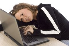 Bored/tired female teenager at the laptop Stock Photos