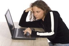 Bored/tired female teenager at the laptop Royalty Free Stock Photos