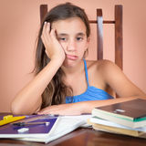Bored and tired hispanic student Royalty Free Stock Image