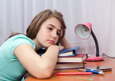 Bored and tired student after hard work. Back to school concept Royalty Free Stock Images
