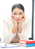 Bored and tired woman behid the table Royalty Free Stock Photo