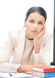 Bored and tired woman behid the table Stock Image