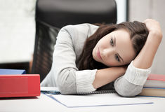 Bored and tired woman behid the table Stock Photography
