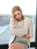 Bored and tired woman with documents Stock Photos