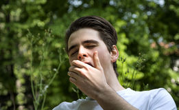 Bored or tired young man yawning Royalty Free Stock Photo