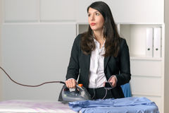 Bored unhappy housewife doing the ironing Royalty Free Stock Image
