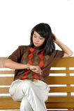 Bored waiting. Young woman was looking at his watch isolated on white background Stock Photo