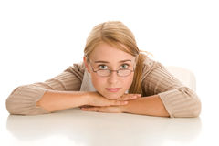 Bored woman behind desk Royalty Free Stock Images