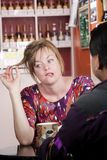 Bored woman in coffee house with male friend Stock Photo