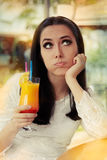 Bored Woman with Colorful Cocktail Drink Royalty Free Stock Photo