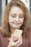 Bored Woman On Diet Eating Crispbread At Home Royalty Free Stock Photo