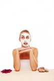 Bored woman in a face mask Stock Photo