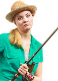Bored woman with fishing rod, spinning equipment Royalty Free Stock Photos