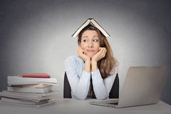Bored woman, funny looking student with book on head Stock Images