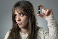 Bored Woman with Chess Piece Royalty Free Stock Photo