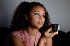 Bored woman holding television Royalty Free Stock Images