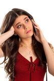 Bored woman holds cell phone. Stock Image