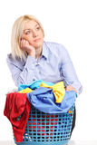 Bored woman leaning on a laundry basket Stock Photography