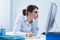 Bored woman at office Royalty Free Stock Images
