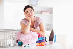 Bored Woman with a pile of clothes Stock Image