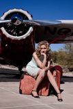 Bored woman by a private plane Royalty Free Stock Image