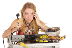 Bored woman repairing computer Royalty Free Stock Images