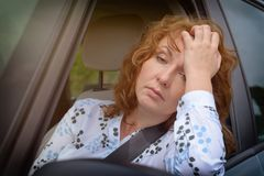 Bored woman in the traffic jam Stock Images