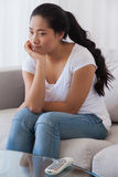 Bored woman sitting on couch Stock Photography