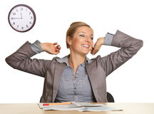 Bored woman sitting at the desk Stock Photo