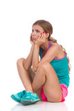Bored Woman In Sports Clothes Sitting On Floor Stock Image