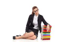 Bored woman with stack of books Stock Photography