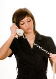 Bored woman with telephone Stock Photography