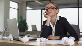 Bored woman thinking over startup in office, lacking new ideas, unmotivated. Stock footage stock video