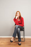A bored woman waiting Stock Image
