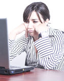 Bored woman at work Stock Image