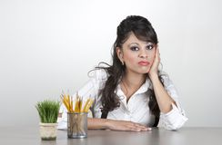 Bored woman at work stock images