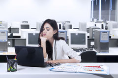 Bored woman working with laptop Stock Photography
